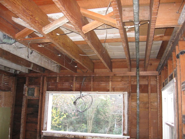 kitchen remodel studs and joists exposed after demolition