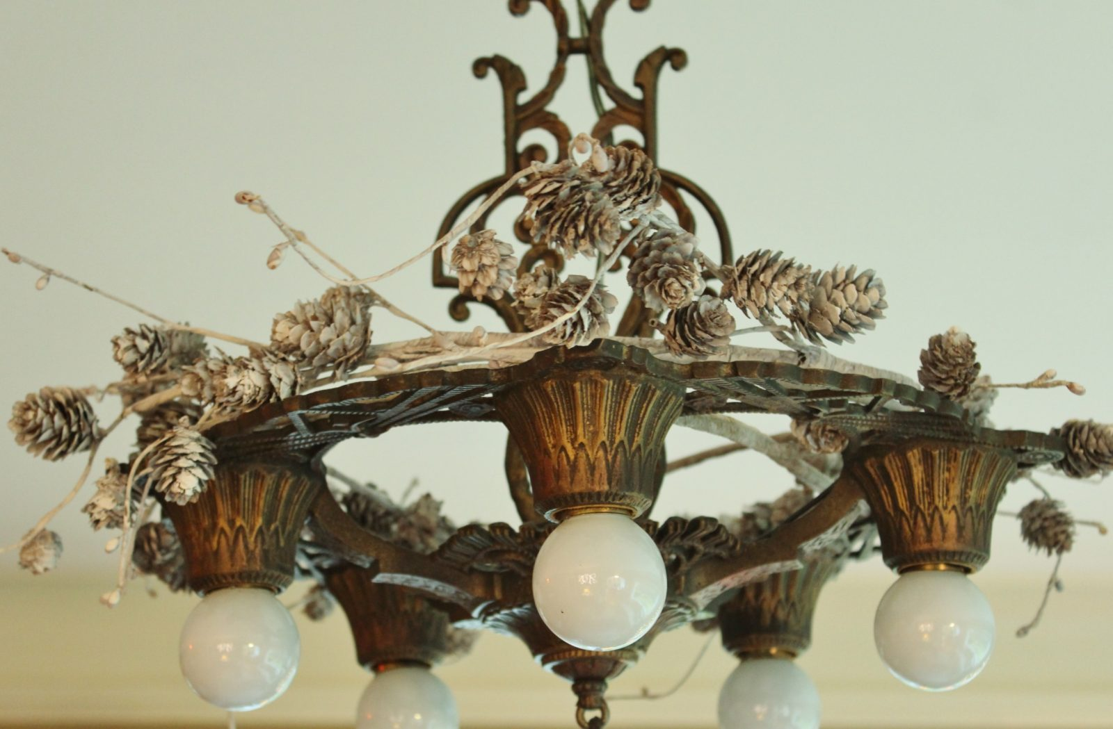 holiday pinecones on a 1920s era chandelier.